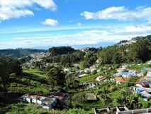 Valley view of Kodaikanal hill station in Tamil Nadu, India. Clouds rolling on the small hill villages visible among the green hills of Kodaikanal in India royalty free stock photography