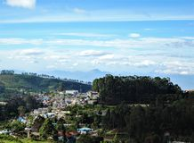 Valley view of Kodaikanal hill station in Tamil Nadu, India. Clouds rolling on the small hill villages visible among the green hills of Kodaikanal in India royalty free stock photos