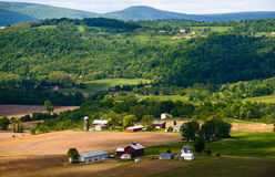 Valley View in Rural Pennsylvania. View of a valley showing layers of farmhouses, barns and gentle gradations of green color in rural Pennsylvania Royalty Free Stock Photo