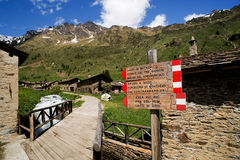Valley  of Viso. Valley of Viso (Bs), Valcamonica, Lombardy,Italy, The houses of Viso, an  ancient village,a tourist signs Royalty Free Stock Photo