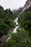 Valley and Waterfall. A valley in the Huangshan Mountains (Yellow Mountains) in Anhui province, China in foggy weather Royalty Free Stock Image