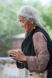 vallfärda ber tibetant unidentified royaltyfri foto