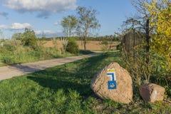 Vallfärda tecknet - Camino de Santiago - Touristic tecken - Polen Royaltyfria Bilder