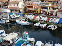 Vallon des Auffes port, Marseilles, France. View of houses and small boats aligned at the port of Vallon des Auffes, Marseilles, France Stock Photography