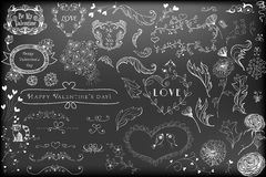 Valntines day design elements. Various hand - drawn Valentines day design elements - hearts, frames, flowers, dividers, birds on chalkboard background Royalty Free Stock Image