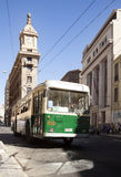 Valparaiso. Chile-February 05, 2014:Old trolley on a street in  in front of watch Turri building in the middle of the street, downtown of  in a sunny day, and Royalty Free Stock Photos