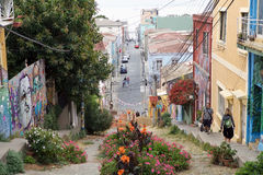 Valparaiso, Chile. People are walking along a traditional street in Valparaiso, Chile. Valparaiso was declared a World Heritage Site by UNESCO in 2003 Stock Photo