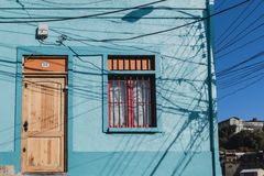 Valparaiso colorful house with power lines shadows from utility poles Royalty Free Stock Image