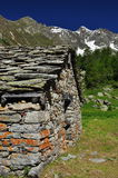 Valpelline, Aosta Valle, Italy. Traditional stone hut stock image