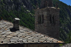 Valpelline, Aosta Valle, Italy. Traditional stone slab roof and bell tower Royalty Free Stock Photo