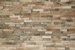 Vals de baksteen van de steenmuur behang als achtergrond Stock Afbeeldingen