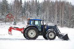 Valtra Tractor Removes Snow with Bucket and Road Drag Stock Images