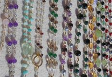 Valuable necklaces in gold and gemstones. Many valuable necklaces in gold and gemstones for sale at market Stock Photography