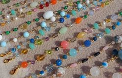 Valuable necklaces in gold and gemstones for sale at flea market Stock Photo