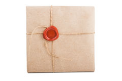 Valuable package. Sending packed in thick paper, tied with a rope and stamped wax seal isolated on white background Royalty Free Stock Photo