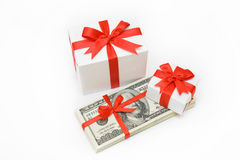 Valuable present. The isolated pack dollars lies among Christmas gifts Royalty Free Stock Photography