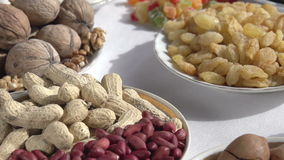 Valuable Ration. Past the camera slowly moving small plates with different kinds of nuts and dried fruits stock footage