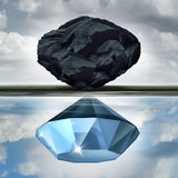 Valuation Vision. Seeing the possibilities of value opportunity as a wealth financial visualization concept as a rock or coal making a reflection in the water Royalty Free Stock Photography