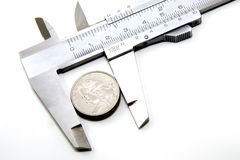 The value of 25 cents. 25 cents in a caliper (the concept of the value of 25 cents stock image