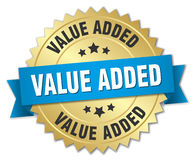 Value added 3d gold badge. With blue ribbon Royalty Free Stock Photos