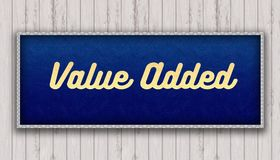 VALUE ADDED handwritten on blue leather pattern painting hanging. On wooden wall. Illustration Royalty Free Stock Photo