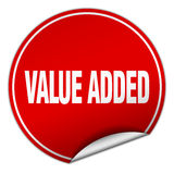 Value added round red sticker. Isolated on white Royalty Free Stock Images