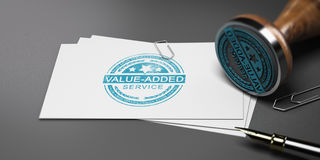 Value Added Service, VAS. Value added stamp printed on a card with office supplies. 3D illustration Stock Photos