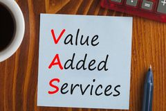 Value Added Services Acronym. VAS - Value Added Services written note on the wooden desk with pen aside. Acronym business concept. Top view royalty free stock images