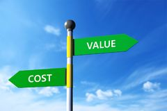 Value and cost. In arrow sign board,sky background Royalty Free Stock Photo