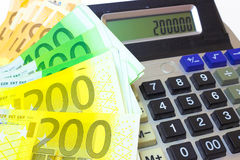 Value of Money. Banknotes of the European Union in addition to the calculator, photography Royalty Free Stock Image