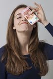Value for money concept for fun smiling 20s woman Royalty Free Stock Image