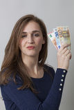 Value for money concept for proud Euro 20s woman Stock Photo