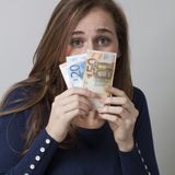 Value for money concept for scared 20s woman Stock Images