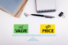 Value and Price Balance concept. Paper scale on a white table.  Royalty Free Stock Images