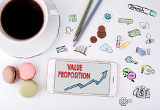 Value Proposition, Business Concept. Mobile phone and coffee cup Royalty Free Stock Image