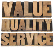 Value, quality, service. Business mantra concept - isolated words in vintage letterpress wood type printing blocks Stock Photography
