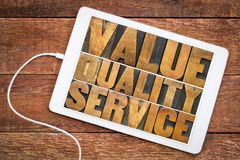 Value, quality, service word abstract. Value, quality, service - business mantra or motto concept - word abstract in vintage letterpress wood type printing stock photo