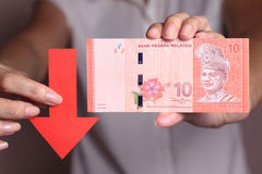 Value of the ringgit malaysia falling Royalty Free Stock Image
