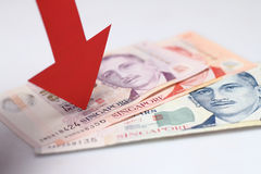 Value of the Singapore dollar falling Stock Photo