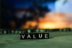Value on wooden blocks. Cross processed image with bokeh background stock image