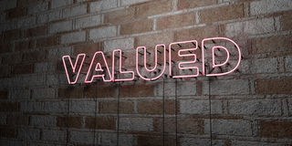 VALUED - Glowing Neon Sign on stonework wall - 3D rendered royalty free stock illustration Stock Photography