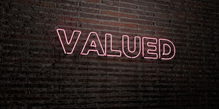 VALUED -Realistic Neon Sign on Brick Wall background - 3D rendered royalty free stock image Stock Images