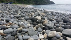 Valugan boulder beach. In Batanes Stock Image