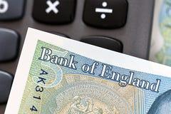 Valuta britannica - una nota da cinque libbre Fotografie Stock