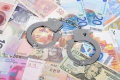 Valuta con le manette Fotografie Stock Libere da Diritti