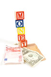 Valuta countries with money on wooden blocks. Valuta different countries with money on wooden blocks over white royalty free stock image