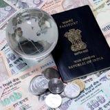 Valuta indiana con il glob di vetro e del passaporto Immagine Stock Libera da Diritti