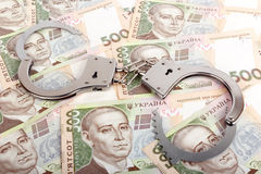 Valuta ucraina e manette fotografia stock libera da diritti