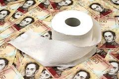 Valuta venezuelana con la carta igienica immagine stock libera da diritti