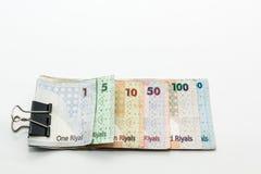 Valute del Qatar cento riyal, cinquecento riyal, cento riyal, cinquanta riyal, dieci riyal, cinque riyal ed un riyal Fotografie Stock Libere da Diritti